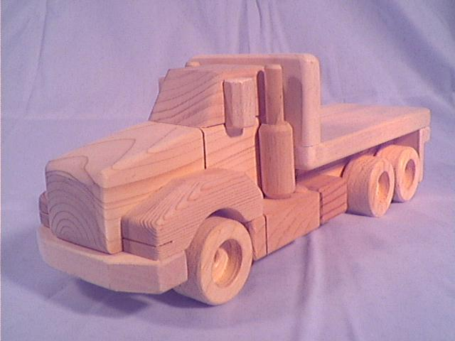 more versatile wooden toy trucks our tandem flatbed can carry wooden ...